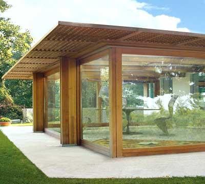 Progetto di una veranda moderna in legno a Pavia